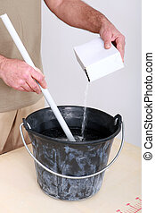 Man mixing up plaster