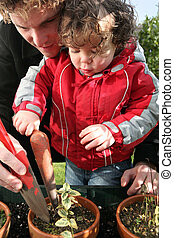 young father and toddler gardening