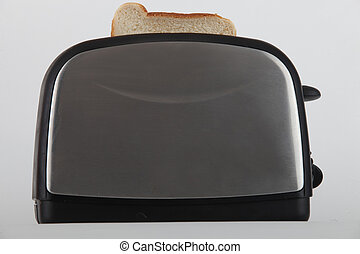 Slice of white bread in a toaster