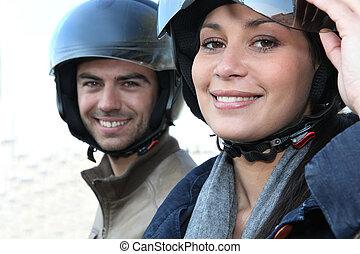 Couple wearing motorbike helmets