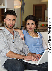 Couple sitting on couch