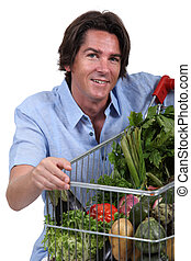 portrait of a man with vegetable trolley