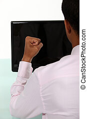 Businessman with clenched fist