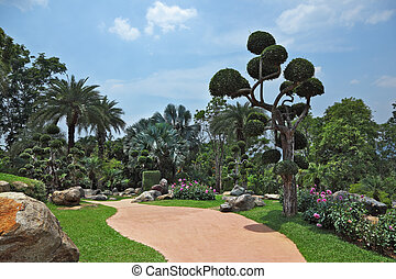 Palm trees and flowers - A masterpiece of landscape design -...