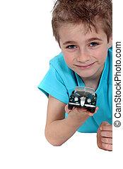 Boy with a toy car