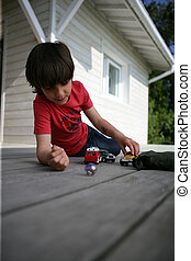 Boy playing with toy cars