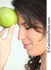 Woman with an apple