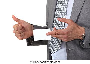 Man displaying business card