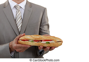 Businessman holding long sandwich
