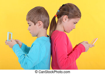 Brother and sister with hand-held video games