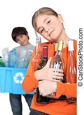 Children recycling glass bottles