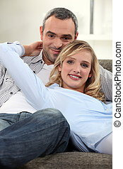 Couple lounging comfortably on a sofa
