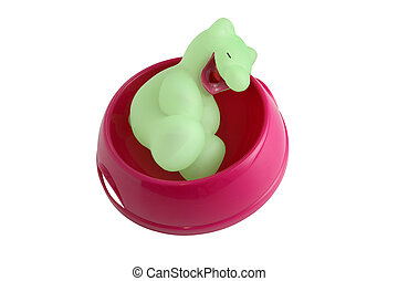 Squeaky toy in dog bowl