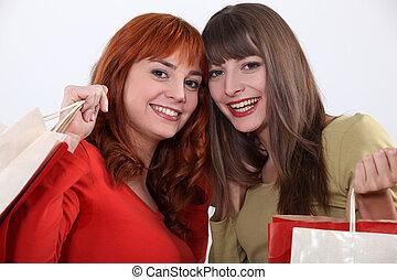 two girlfriends shopping