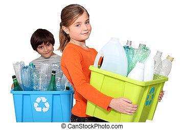 Children recycling plastic bottles