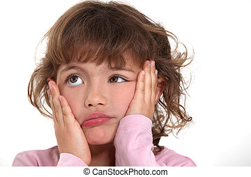 little girl sulking