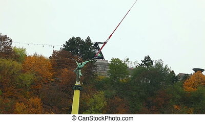 Prague Metronome monument in autumn forest