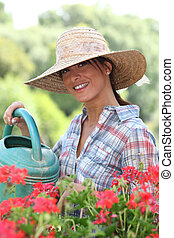 Woman watering her plants on a sunny spring day