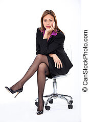 Corporate woman on a chair.