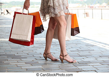 close-up of two girls with shopping bags