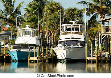 sport fishing yachts - two sport fishing yachts on private...