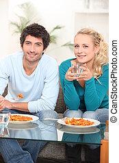 young couple eating ravioli