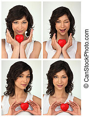 photo booths of young brunette with red heart