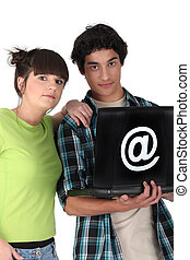 Teenagers surfing the internet