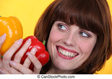 Woman with peppers