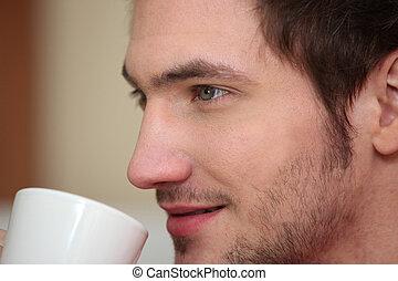 Closeup of a young man with a mug
