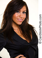 Smiling head shot - Head shot of a beautiful Hispanic hair...