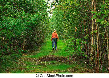 Man Walking in the Forest