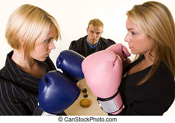 Court battle - Two women lawyers wearing boxing gloves...