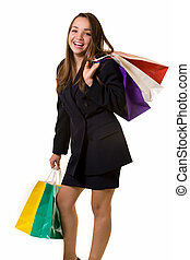 Happy shopper - Attractive young brunette woman wearing...