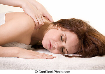 Having a massage - Attractive auburn haired woman laying on...