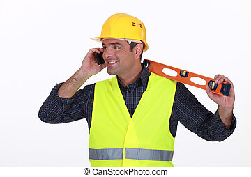 Tradesman talking on the phone