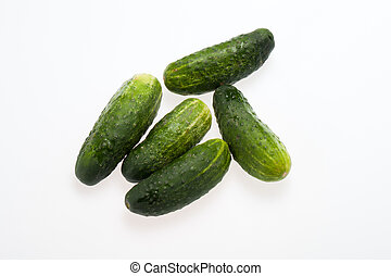 A fresh green cucumber isolated on a white background