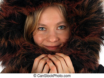 Smiling young woman with a fur hood