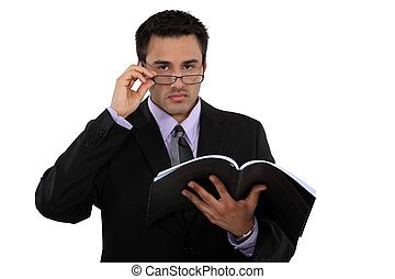 young businessman reading a report