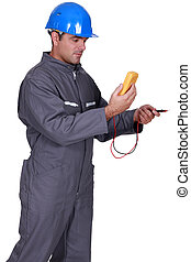 Electrician with voltmeter