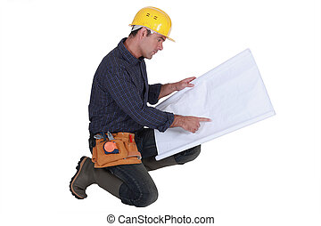 Engineer reading plans