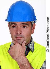 A worried tradesman