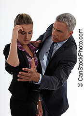 young woman having migraine comforted by mature gentleman