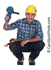 craftsman holding an electric saw