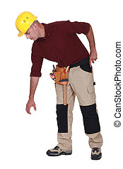 Construction worker reaching down to empty copyspace
