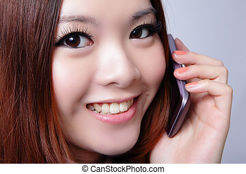 woman speaking cell phone with sweet smile