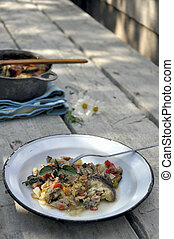 Rustic dish - A rustic dish served on a wooden table