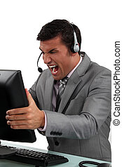 Businessman shouting at his computer