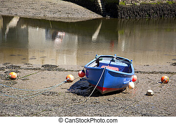 Rowing boat - Generic rowing boat at low tide. All...