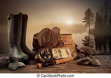 Fly fishing equipment on deck with view of a misty lake...